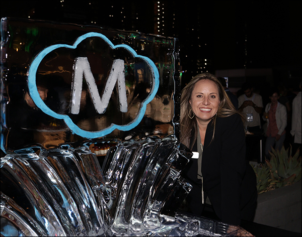 DeAnna Rogers posing with the Maropost ice sculpture at the Maropost Reception at Content & Commerce Summit 2017